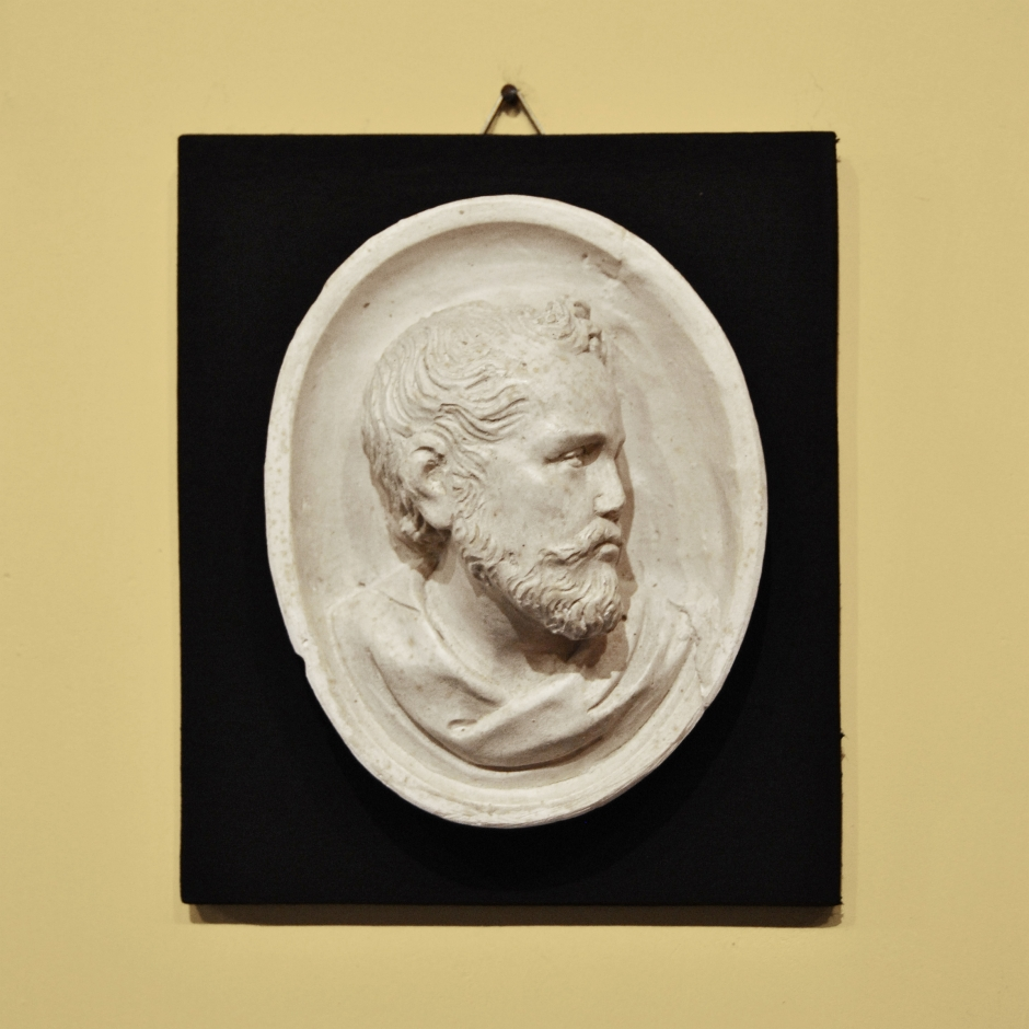 Oval with male profile